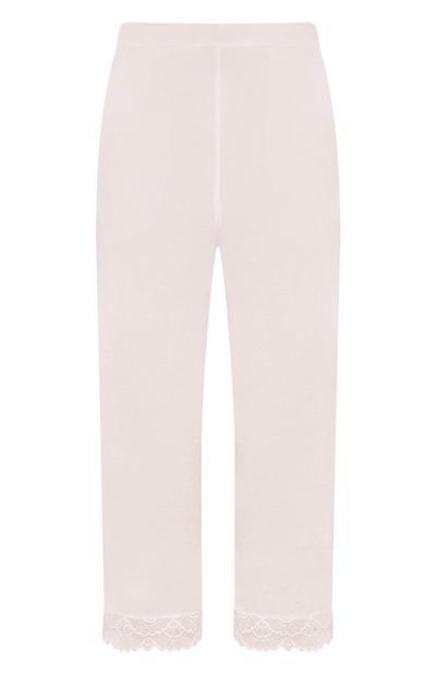 Pantaloni rosa in raso con bordo in pizzo