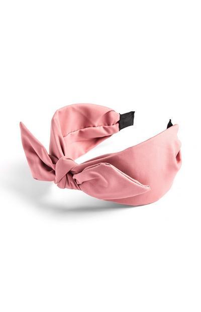 Naglavni trak z rožnato pentljo