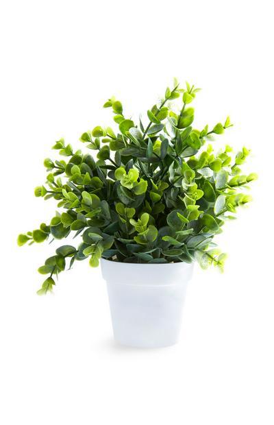 Kleiner Kunstpflanze mit weißem Blumentopf