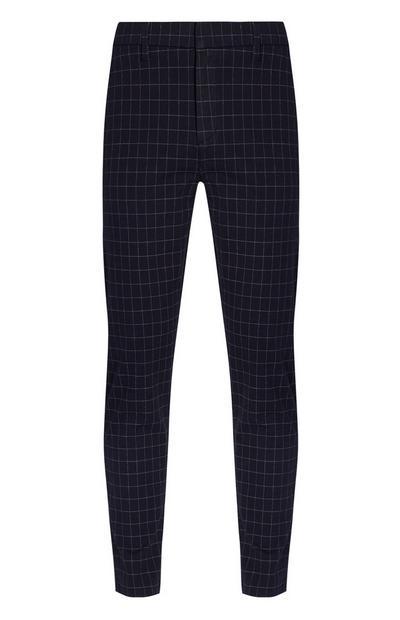 Pantaloni blu navy elasticizzati modello slim con stampa a quadri sottili
