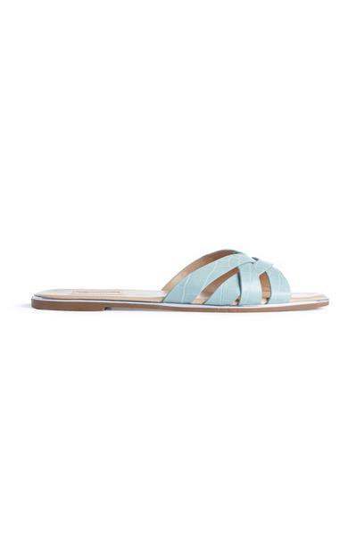 Zapatos destalonados trenzados en color azul con efecto piel de cocodrilo