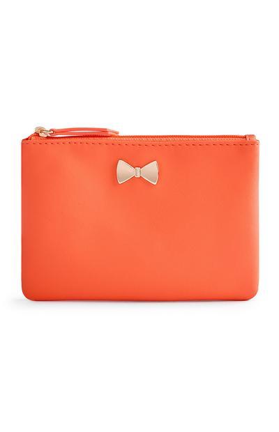 Portamonete arancione con fiocco in metallo