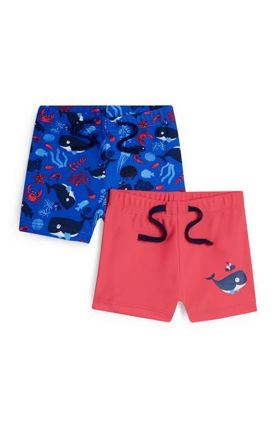 2 costumi da bagno blu e rosso con stampa balena