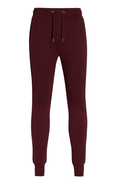 Burgundsko rdeče viseče hlače za prosti čas
