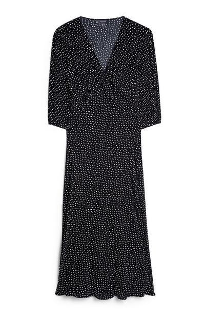 Zwart-witte jurk met V-hals, ruches en stroken