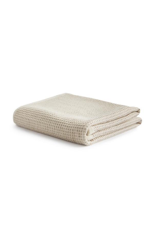 Crèmekleurige handdoek met wafelstructuur