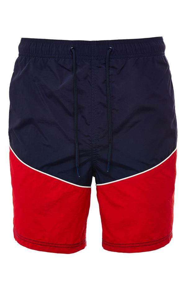Short bleu marine et rouge color block style sportif avec liens à nouer à la taille