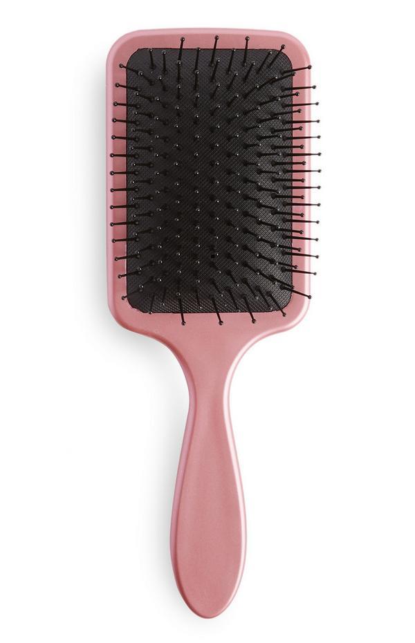 Zachte roze haarborstel