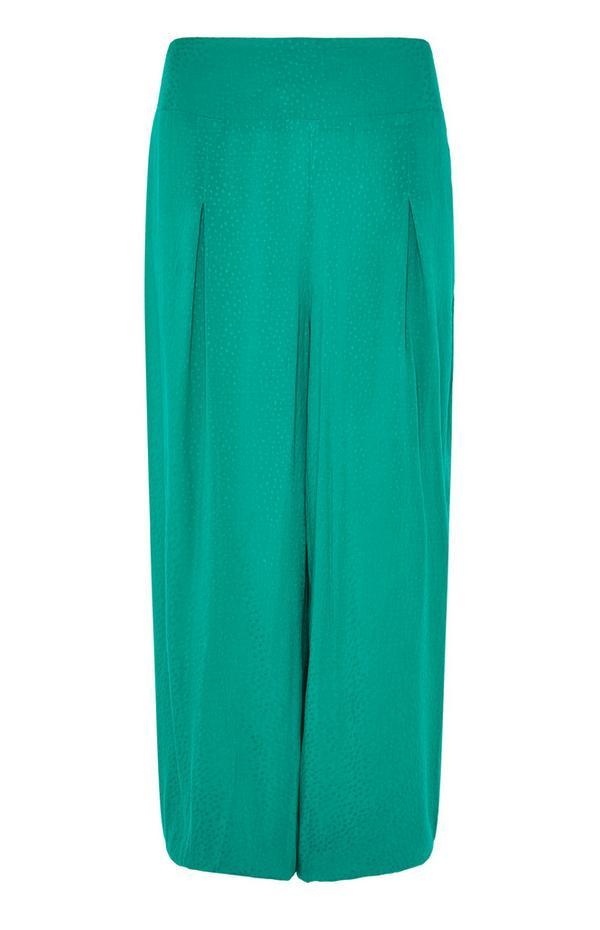 Smaragdne hlače s krivimi hlačnicami