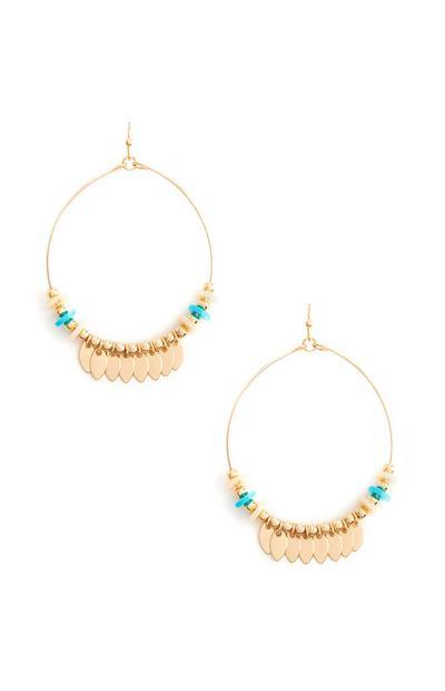 Boucles d'oreilles dorées circulaires ornées de perles