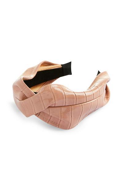 Roze gedraaide haarband van imitatieleer