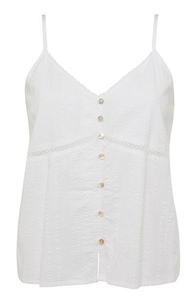 Camiseta blanca de tirantes en tejido mil rayas con botones