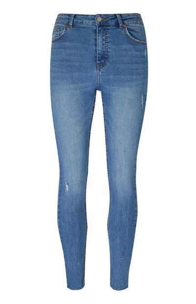 Blauwe skinny jeans met rafelzoom