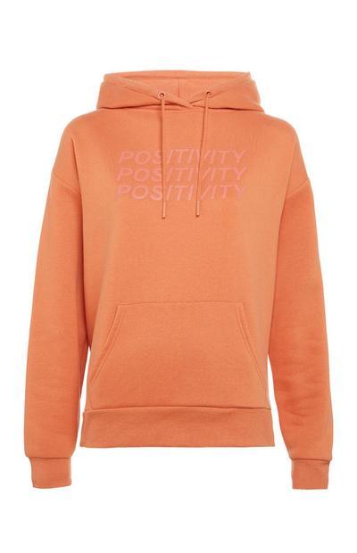 Sweat à capuche orange avec message Positivity et poche sur l'avant