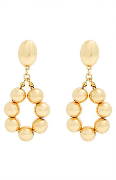 Orecchini pendenti ovali dorati con perline