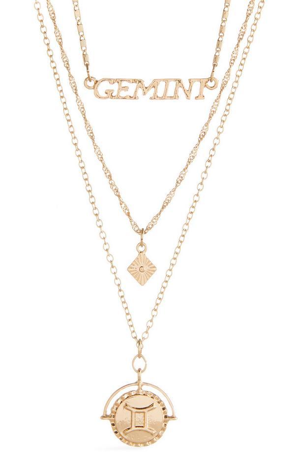 Collana dorata a tre fili con scritta e segni zodiacali