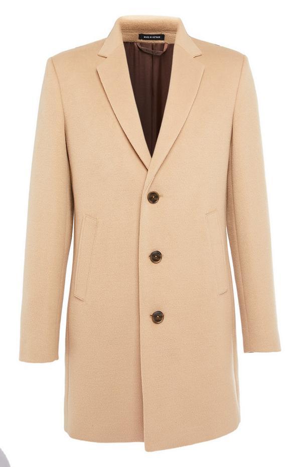 Cremefarbener, eleganter Mantel