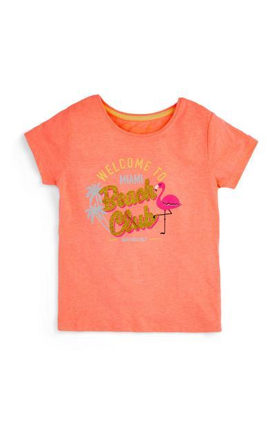 T-shirt color pesca con fenicottero da bambina