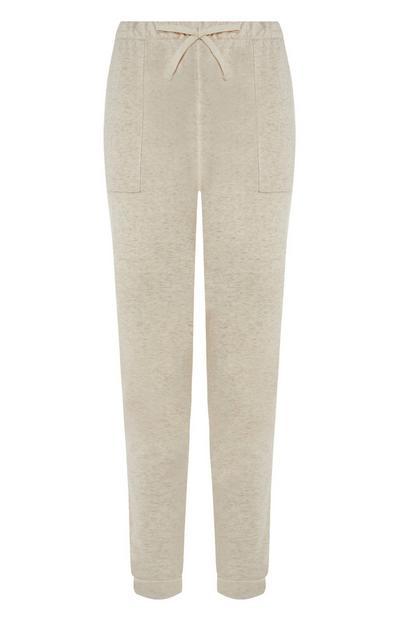 Pantalón de chándal pitillo color crema