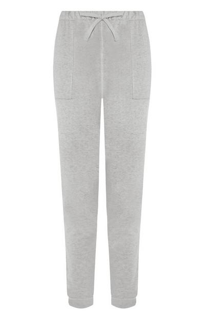 Svetlo sive oprijete hlače za prosti čas