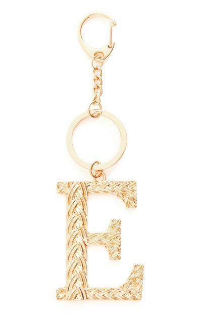 """Goldfarbener Schlüsselanhänger aus Metall mit Initiale """"E"""" in Flechtoptik und Clip"""