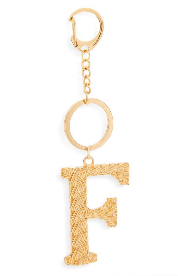 Goudkleurige sleutelhanger met gevlochten metalen letter F