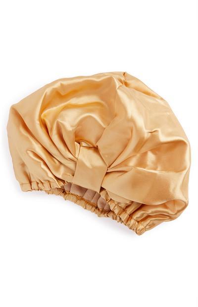 Bonnet de douche doré en tissu