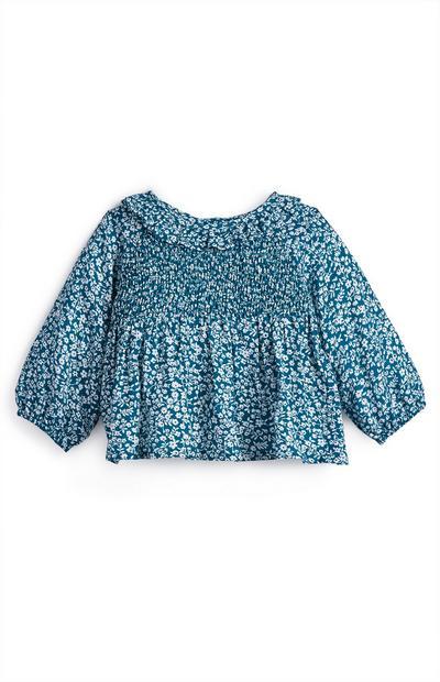 Blusa azul con estampado floral para bebé niña