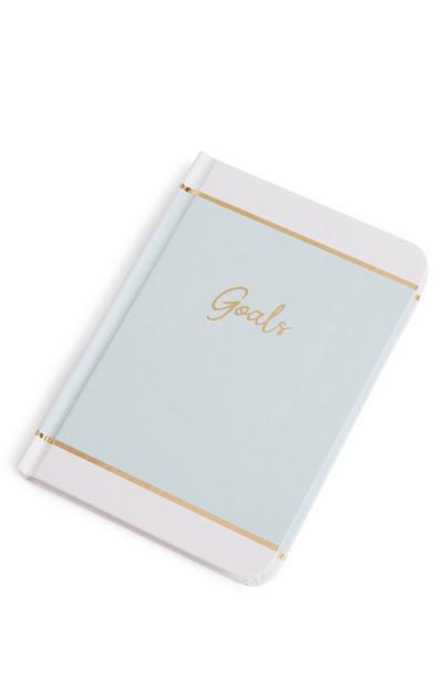 Blauw notitieboek met 'Goals'