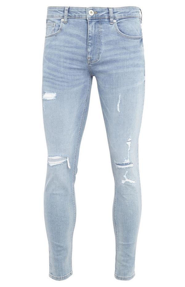 Lichtblauwe superskinny jeans met genaaide scheuren