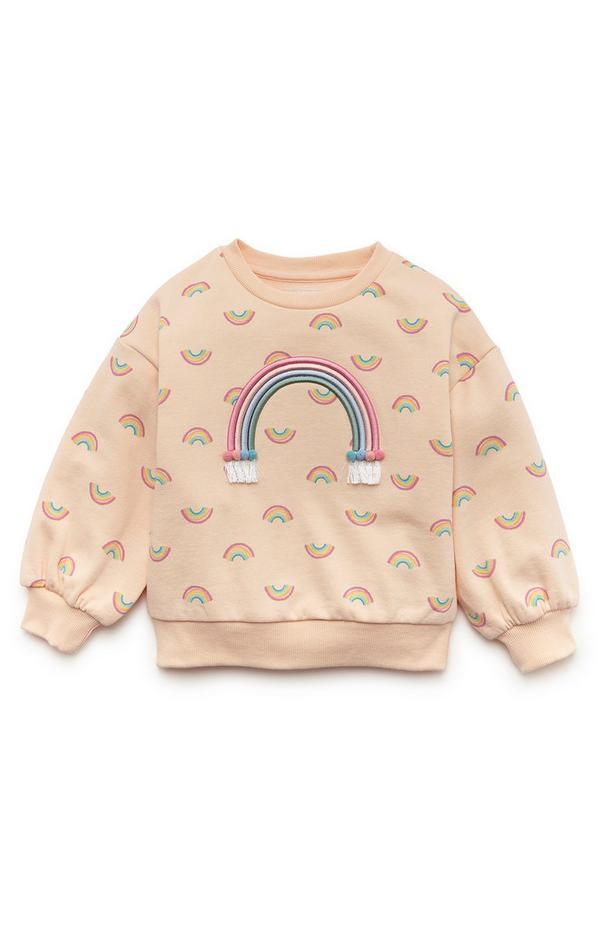 Sudadera color melocotón con cuello redondo y arcoíris para niña pequeña