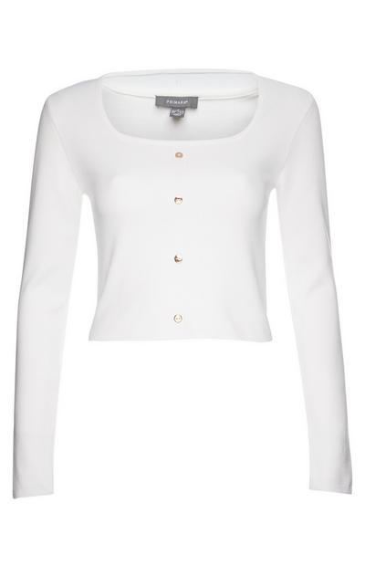 Witte trui met knopen en vierkante hals