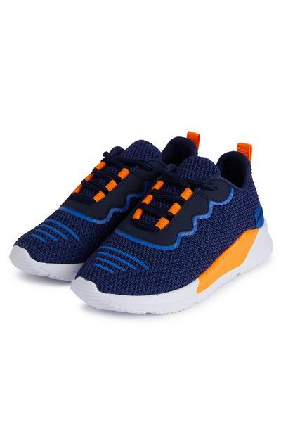 Donkerblauwe en oranje jongenssneakers met phylon-zool
