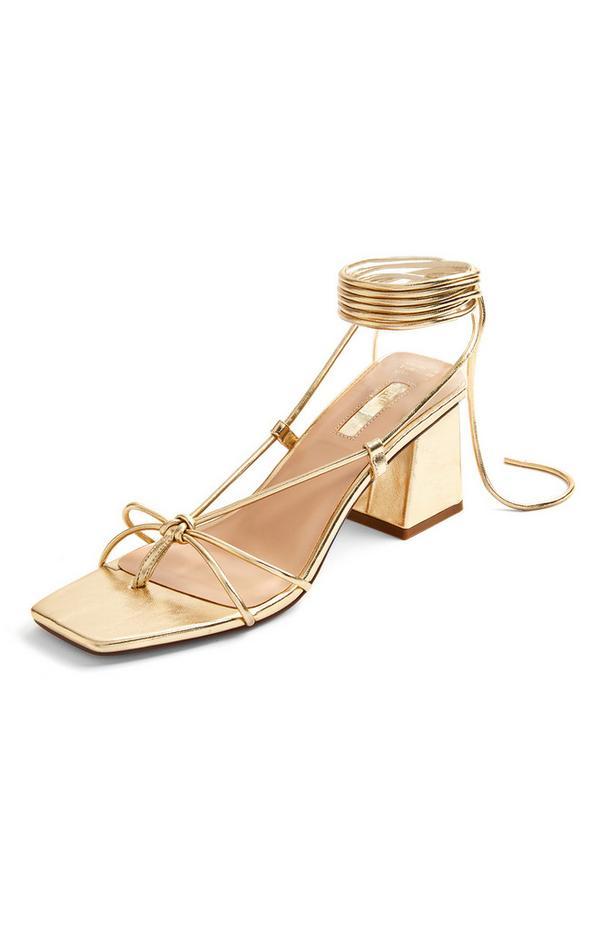 Metallic goudkleurige sandalen met blokhak en enkelstrik