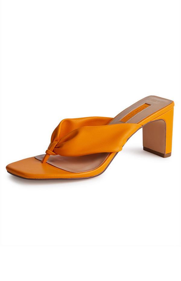 Mules orange à entredoigt avec bride volumineuse et bout carré