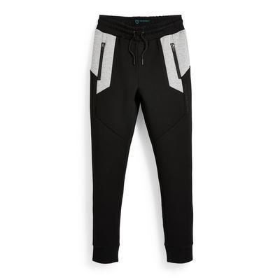 Zwarte sportieve joggingbroek met grijze mesh-inzetstukken voor jongens