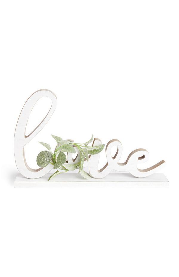 Witte decoratie met bladeren en tekst Love
