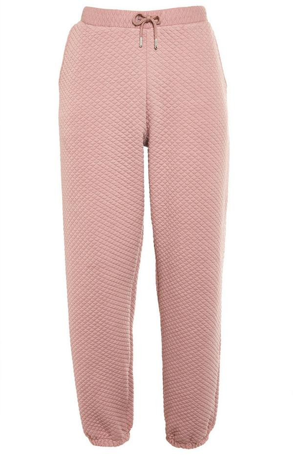 Roséfarbene, gesteppte Jogginghose zum Binden