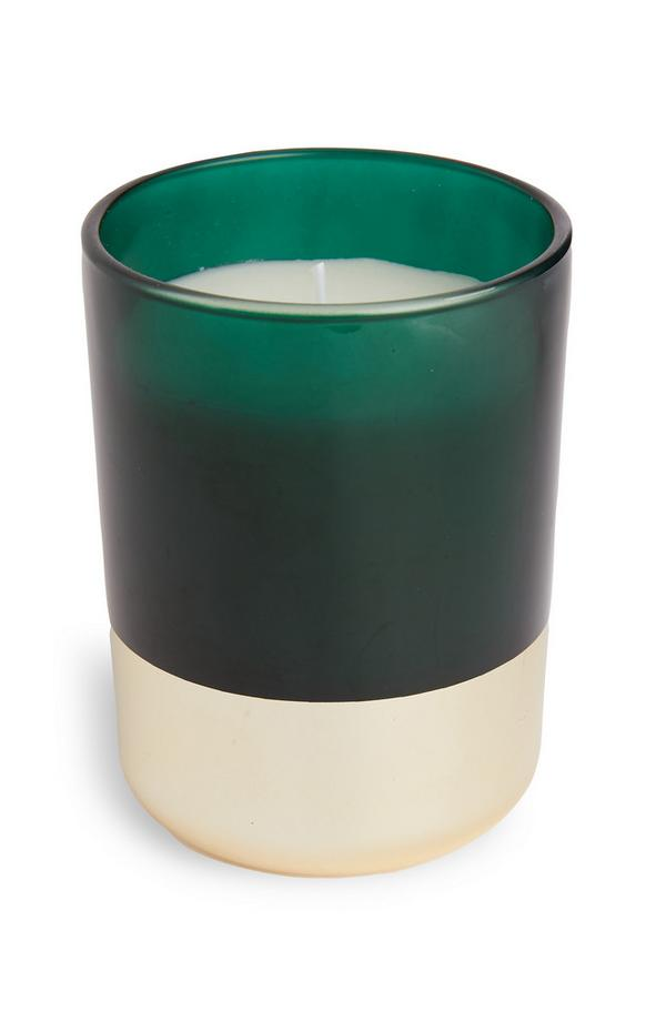 Vela en vaso verde con base dorada