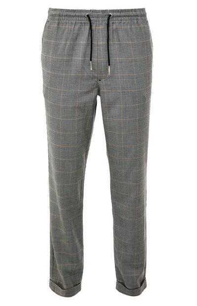 Pantaloni grigi a quadri elasticizzati in vita