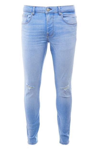 Calças ganga skinny rasgões lavagem desbotada azul