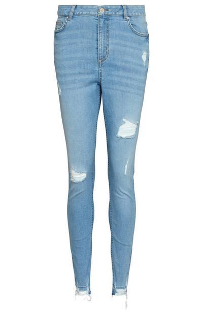 Skinny Jeans in heller Waschung mit ausgelassenem Saum
