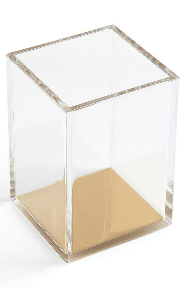 Portalápices transparente con toques dorados
