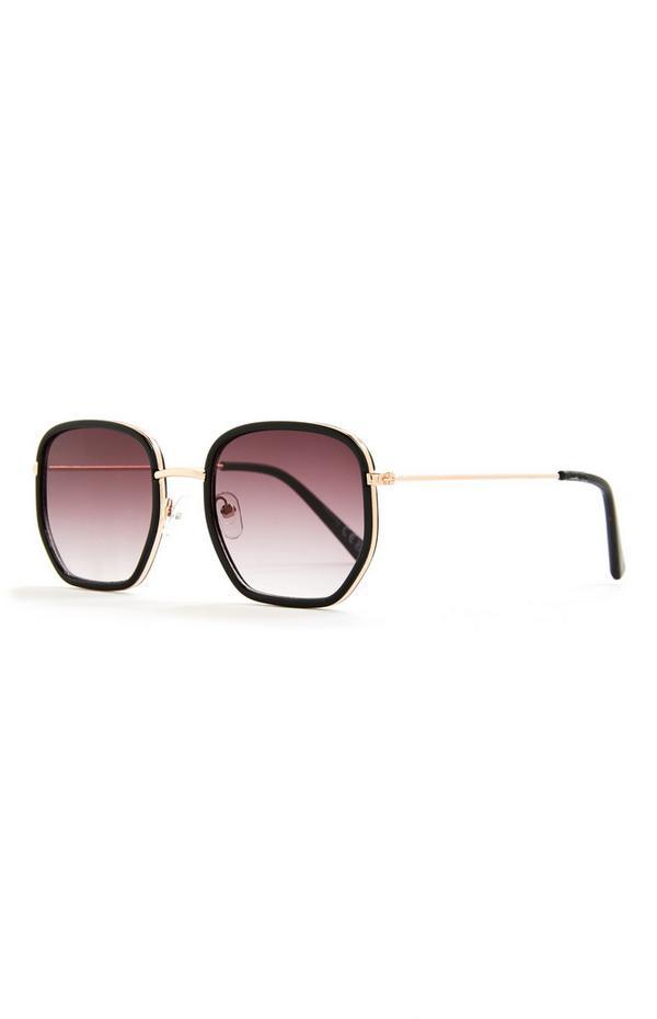 Sechseckige schwarze Sonnenbrille mit goldfarbenen Bügeln