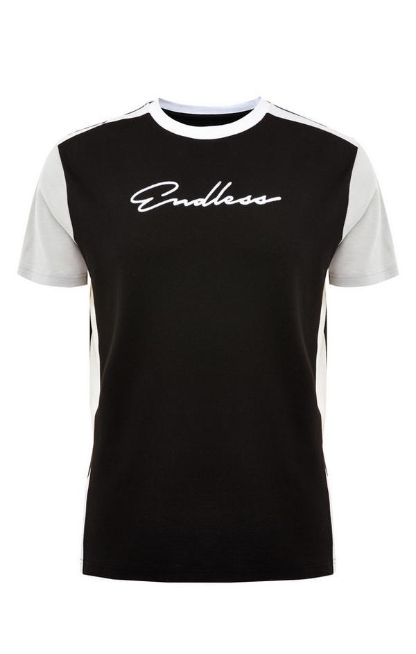 T-shirt bianca e nera con inserti e scritta Endless