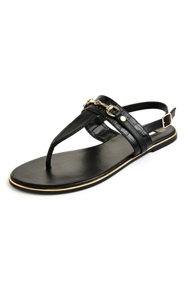 Črne sandale s tankimi paščki, zlatimi detajli in ravnim podplatom