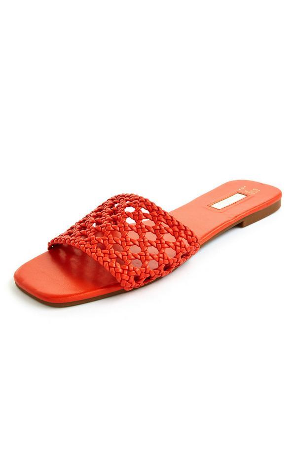 Rode platte gevlochten muiltjes