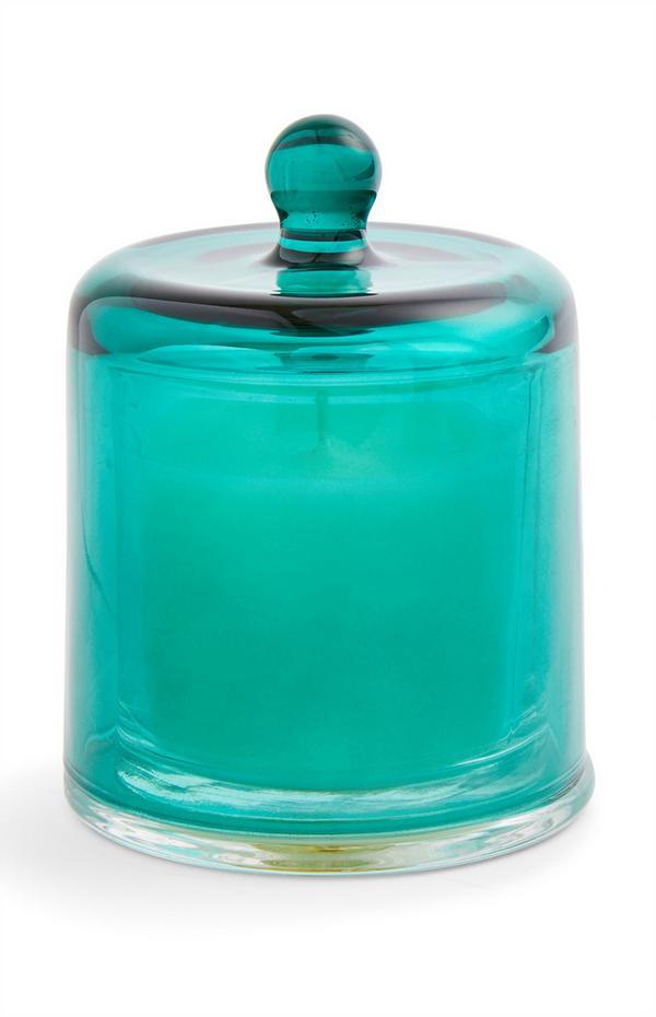 Stimmungskerze mit blaugrüner Glasglocke