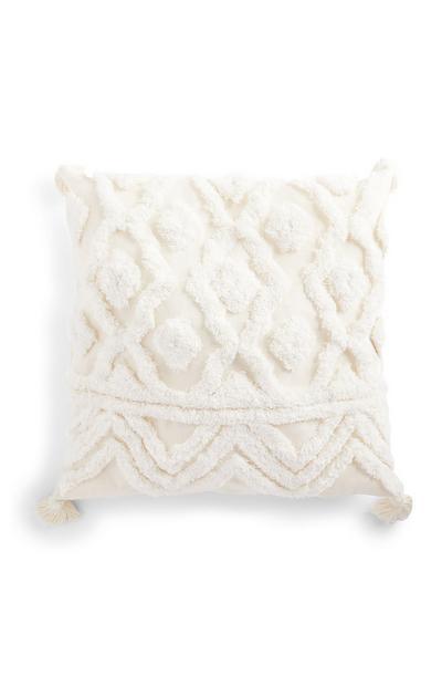 Cojín blanco con textura en relieve y borlas de 50cm x 50cm