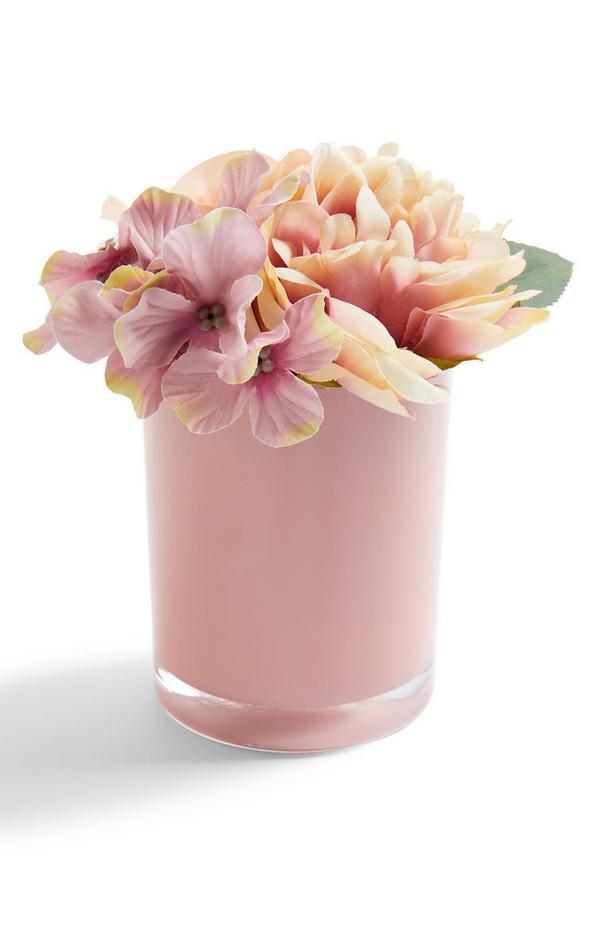 Glanzende ronde roze pot met imitatiebloemen